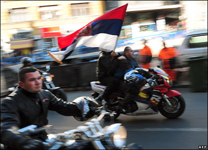 Bikers ride with Serbian flags in Belgrade ahead of a rally to protest against Kosovo's declaration of independence, 21 February 2008