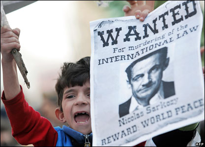 A boy holds a poster of French President Nicolas Sarkozy during protests in Mitrovica, 21 February 2008