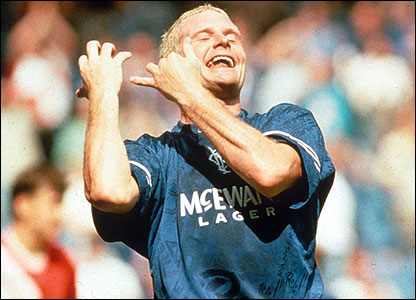 Paul Gascoigne mimes playing a flute