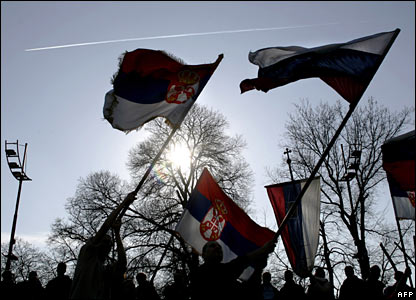 Demonstrators wave Serbian and Russian flags ahead of a rally in Belgrade, 21 February 2008