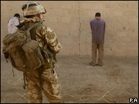 A British soldier with locals in Iraq
