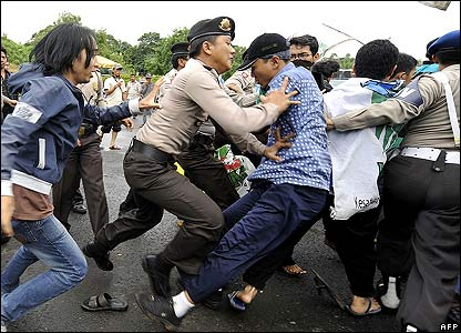 Police officers confront students during a protest outside the presidential palace in Jakarta, Indonesia.