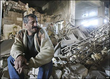 An Iraqi man in Baghdad surveys his shop that was destroyed by a powerful bomb blast