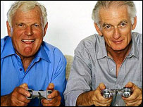 Two older men playing on a games machine
