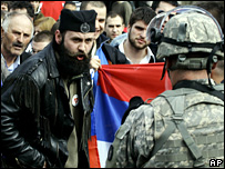 A Serb nationalist shouts at a K-For soldier at protest in Kosovo