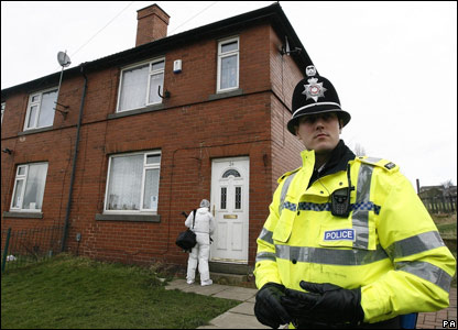 A police forensic officer outside Shannon Matthews' house