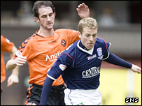 Mark Kerr (left) closes down Falkirk's Billy Clarke