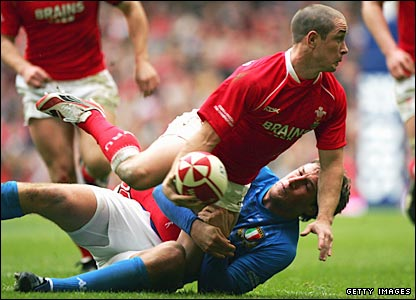 Shane Williams is tackled by Italy's Alberto Sgarbi in Cardiff on Saturday