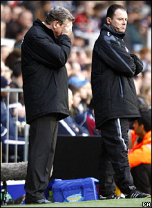Fulham manager Roy Hodgson stands dejected on the touchline at Craven Cottage