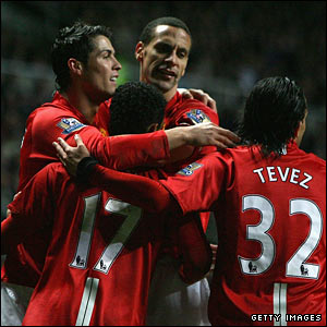 Cristiano Ronaldo of Manchester United celebrates with his team mates after scoring his team's third goal