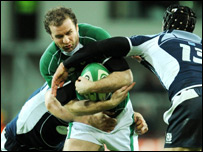Geordan Murphy is tackled by Simon Webster