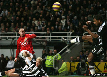 Wayne Rooney of Manchester United scores his team's fourth goal at St James's Park