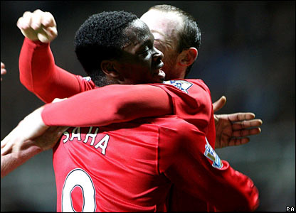 Manchester United's Louis Saha celebrates scoring his sides fifth goal of the match with Wayne Rooney