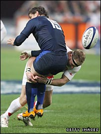 Jamie Noon tackles France's Cedric Heymans leading to England's opening try