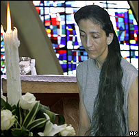 A cut out photograph of Ingrid Betancourt is seen during a mass in Colombia