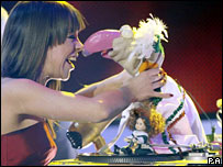 Leona Daly, left, congratulates Dustin the Turkey, 23 February 2008