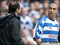 Aston Villa boss Martin O'Neil (left) and Reading's James Harper clash on the touchline