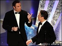 John Travolta and Jon Stewart
