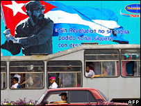 "Cubans in Havana ride a bus past a poster saying: ""Without revolution, it would have not even been possible to dream"" (23 February 2008)"