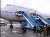 The plane carrying the musicians arriving in Pyongyang