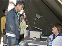 Visitors to the simulated refugee camp are questioned as they register for food rations (Photo credit An Bao/Oxfam)