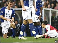 Arsenal striker Eduardo (right) in agony after a tackle by Martin Taylor (left)
