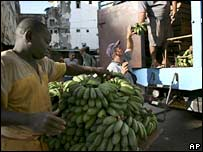 Men unload bananas in Havana