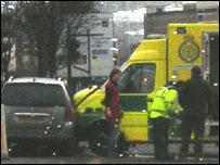 Ambulance crashes into car