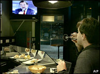 A man watches the televised debate in a Spanish restaurant, 25 February 2008