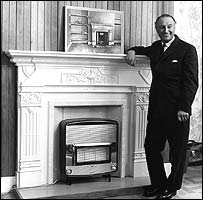 DIY guru Barry Bucknell shows his delight at having boarded up a Victorian fireplace and installed a new gas heater