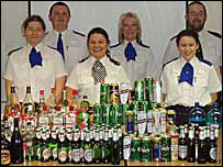 Police officers with some of the confiscated alcohol