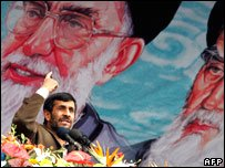 Iranian President Mahmoud Ahmadinejad gestures under a portrait of Iran's Supreme Leader Ayatollah Ali Khamenei on 11 February 2008