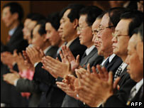 Senior North Korean officials give a standing ovation to the New York Philarmonic orchestra