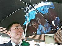Man with umbrella projecting images
