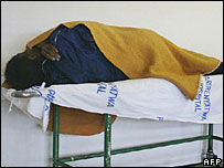 A woman on a trolley at a hospital in Harare