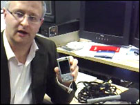Darren Waters holding N95 phone