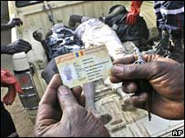 A man holds an ID card recovered from one of three bodies picked up from the streets of N'Djamena following a coup attempt in early February
