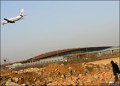 A labourer in front of the new Beijing airport building