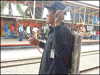 Railway guard with spray canister at Jakarta station