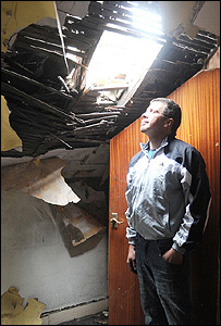 Kleber Afonso surveys the damage to his home in South Yorkshire