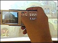 Mobile phone getting information about its location via its camera