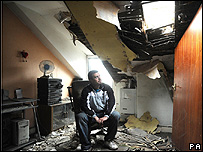 A householder surveys the damage to his home in South Yorkshire