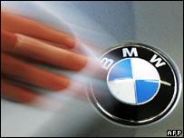 BMW employee polishes car bonnet