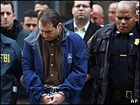A suspect is led away by FBI agents during an operation in Italy and the US, New York 7 February 2008