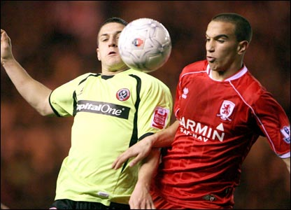 Billy Sharp (left) battles with Emanuel Pogatetz