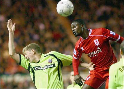 Matthew Kilgallon (left) is beaten in the air by George Boateng