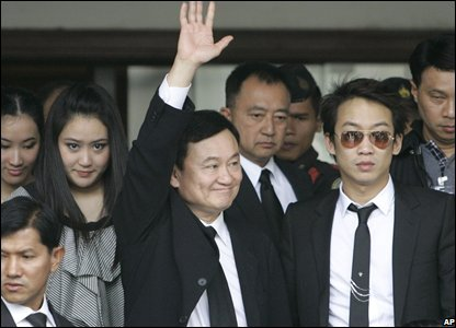 Former Thai PM Thaksin Shinawatra waves to supporters as he leave the Supreme Court in Bangkok, Thailand (28/02/0208)