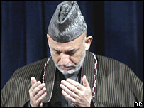File pic of Hamid Karzai praying