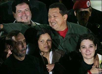 President Hugo Chavez with the freed hostages and his daughter (centre)