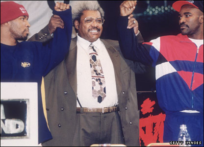 Promoter Don King announces that Holyfield (right) and Tyson will fight